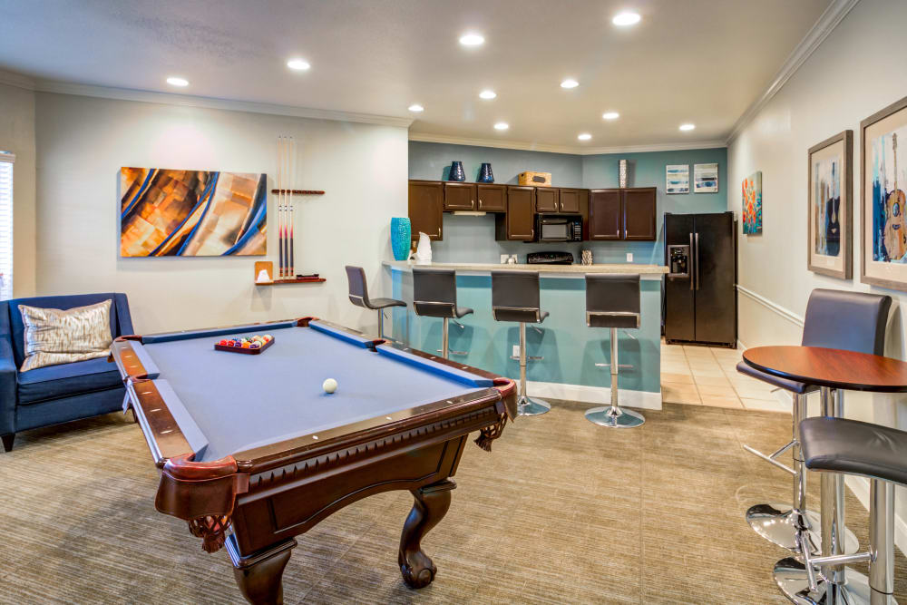 Game room and kitchen at Signature Point Apartments