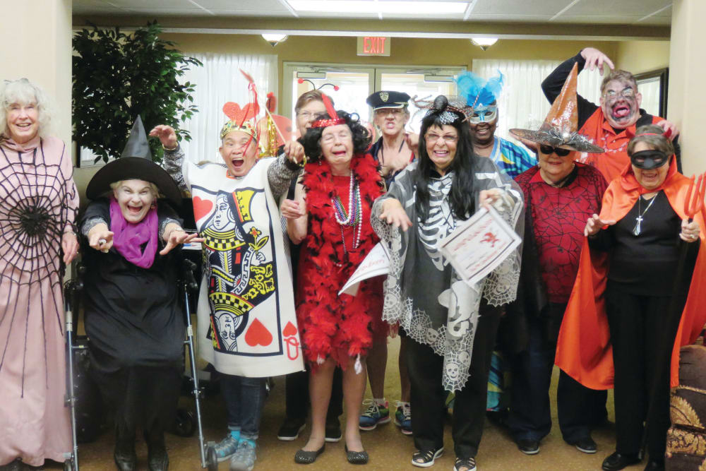 Seniors of Hawthorn Senior Living in Vancouver, Washington posing for a halloween costume photo