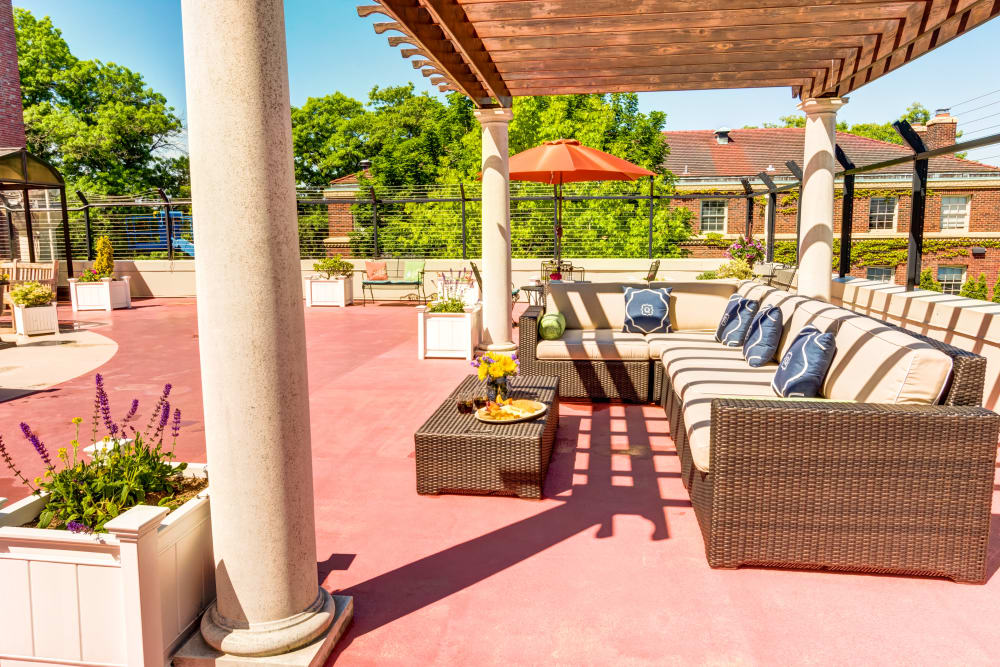 Enjoy the beautiful sunshine on Queen Anne Manor Senior Living's rooftop patio