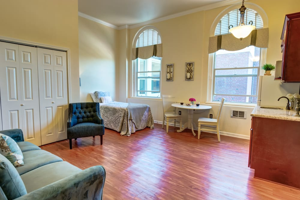 Enjoy rich hardwood floors, high ceilings, and tons of history at Queen Anne Manor Senior Living