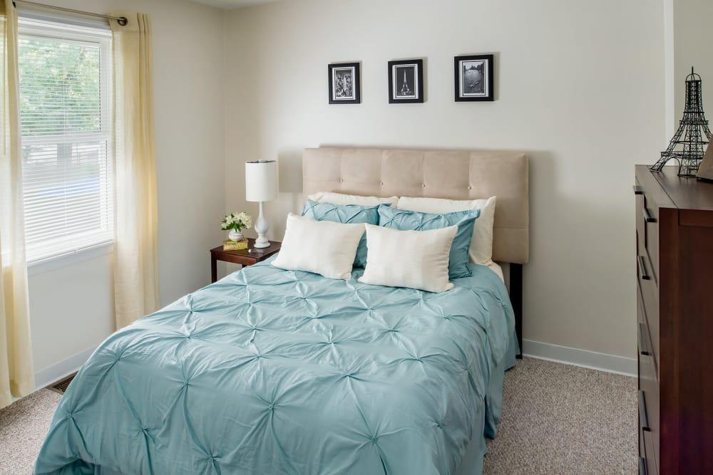 Naturally lit model bedroom at Stony Brook Commons in Roslindale, Massachusetts