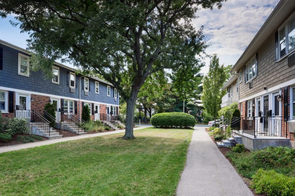 Serene courtyard between resident buildings at Brandywyne Village in East Boston, Massachusetts