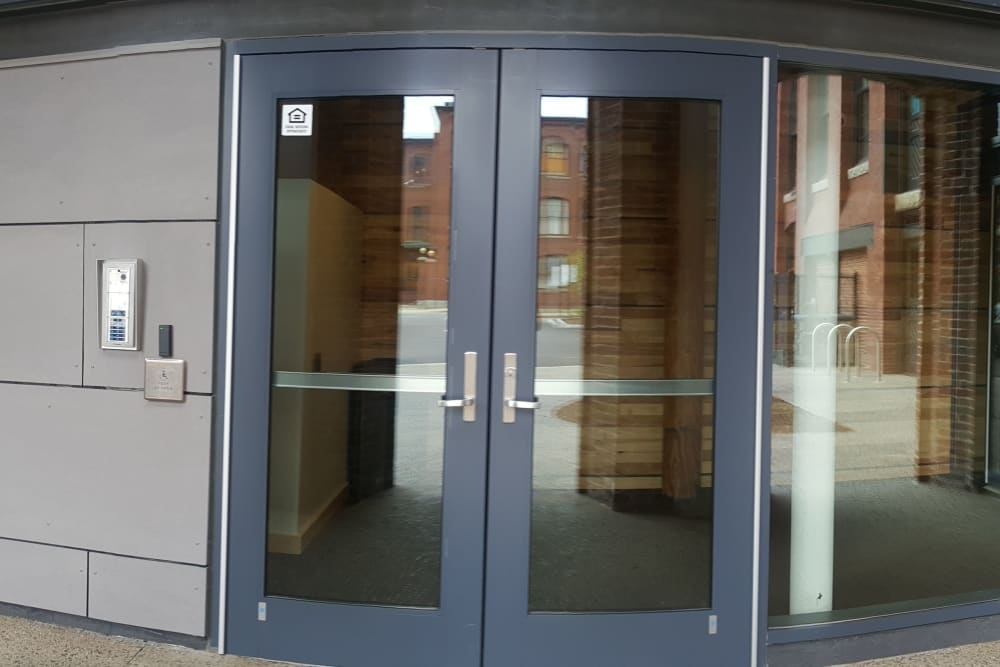 Revolving door in the building at Duck Mill Apartments in Lawrence, Massachusetts