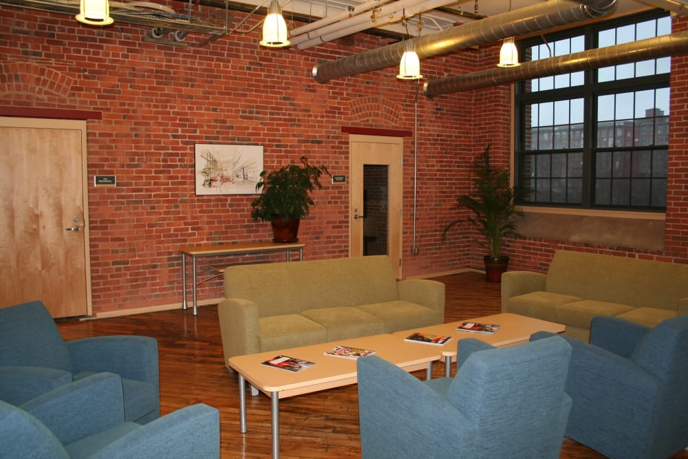 Comfortable seating in the lobby at Union Crossing in Lawrence, Massachusetts