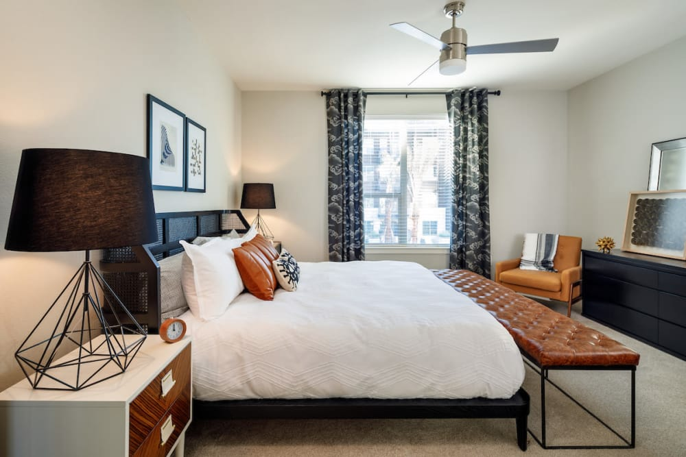 Beautiful model bedroom featuring ceiling fan at Latitude at Presidio in Cedar Park, Texas
