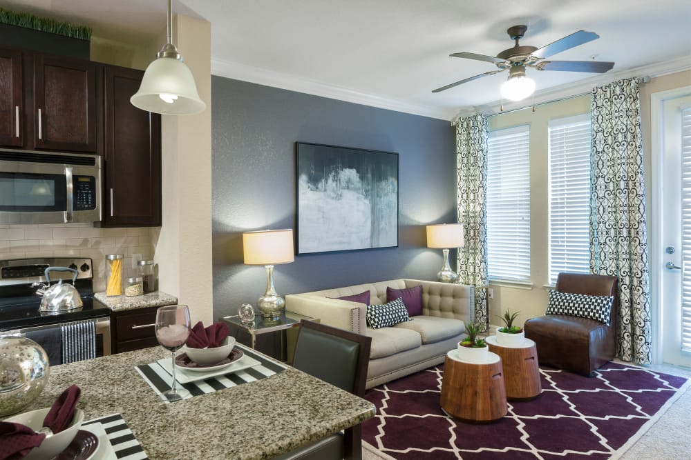 Model Living room at Integra Sunrise Parc Apartments in Kissimmee, Florida