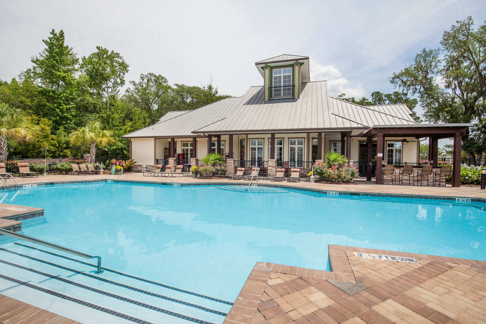Relax poolside at Panther Effingham Parc Apartments in Rincon, GA
