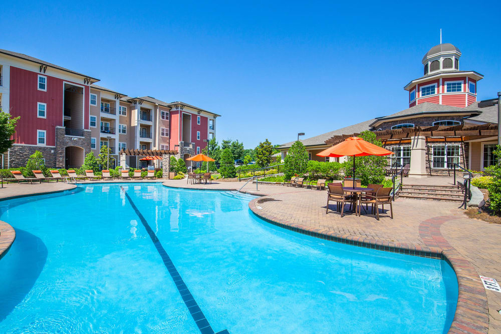 Relax poolside at Integra Hills Apartment Homes in Ooltewah, TN