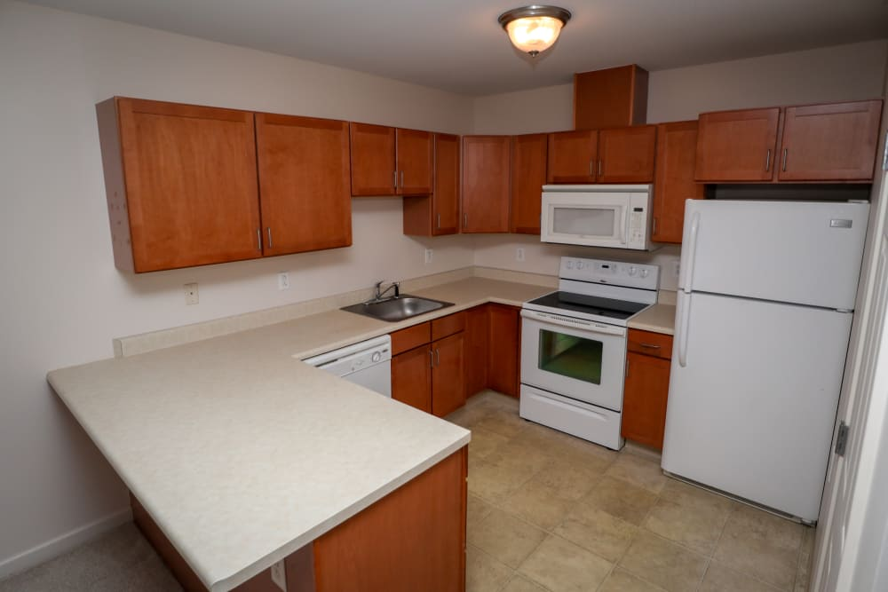 Luxury apartments with a kitchen at Turtle Creek Apartments in Getzville, New York