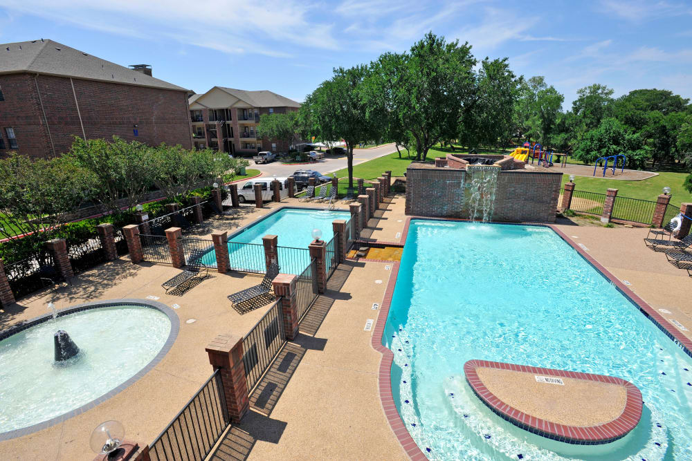 Swimming pool and spa at Carrollton Park of North Dallas in Dallas, Texas
