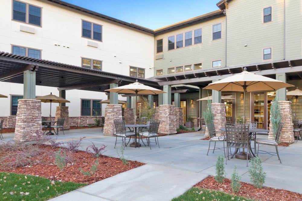 Courtyard with covered seating areas at The Terraces in Chico, California