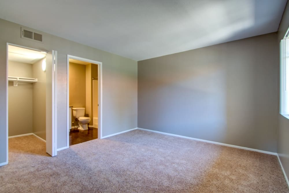 Spacious bedroom at Sunset View Apartments in Oceanside, California