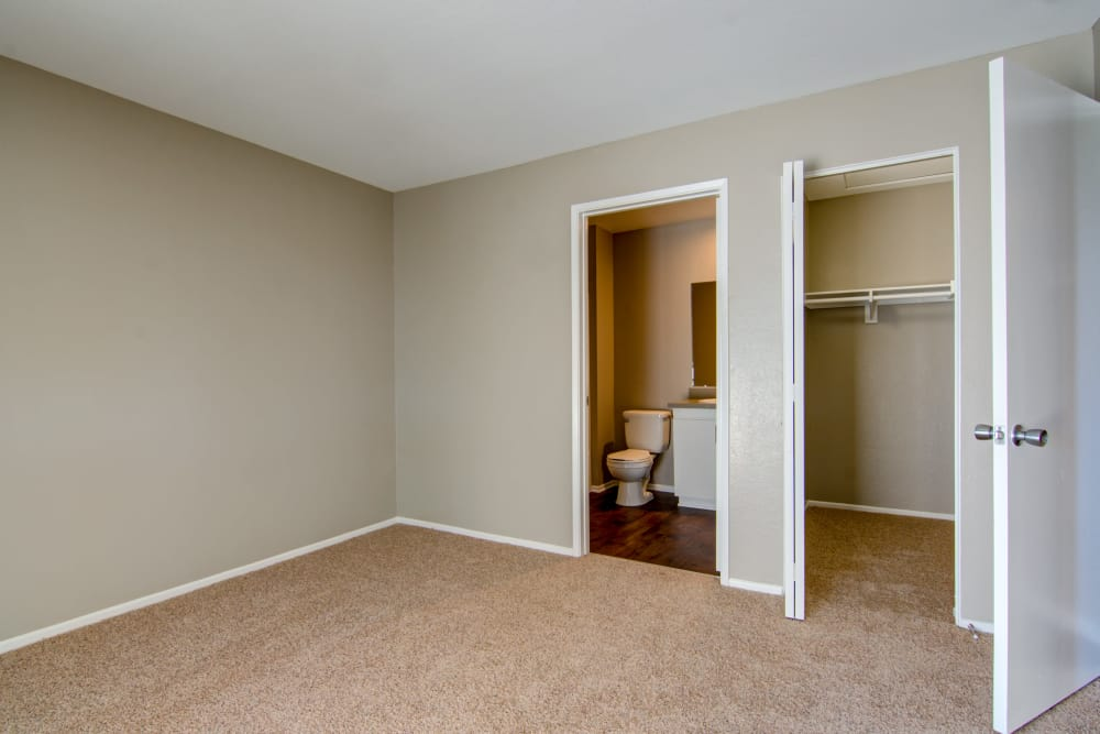 Spacious bedroom with walk in closet at Sunset View Apartments in Oceanside, CA