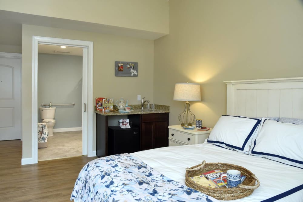 Bedroom with hardwood floors at Symphony at Cherry Hill in Cherry Hill, New Jersey.