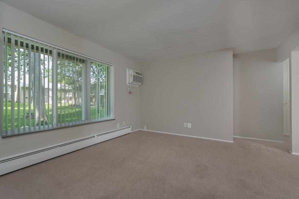 Spacious living room at Ann Arbor Woods Apartments in Ann Arbor, Michigan
