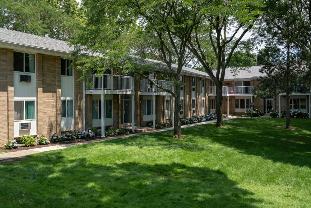 Beautifully manicured landscaping at Ann Arbor Woods Apartments in Ann Arbor, Michigan