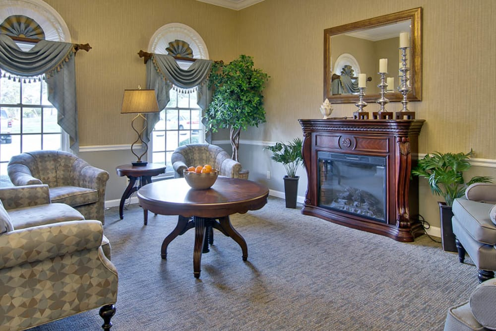 Cozy sitting area by the fireplace at Parkside Senior Living in Rolla, Missouri