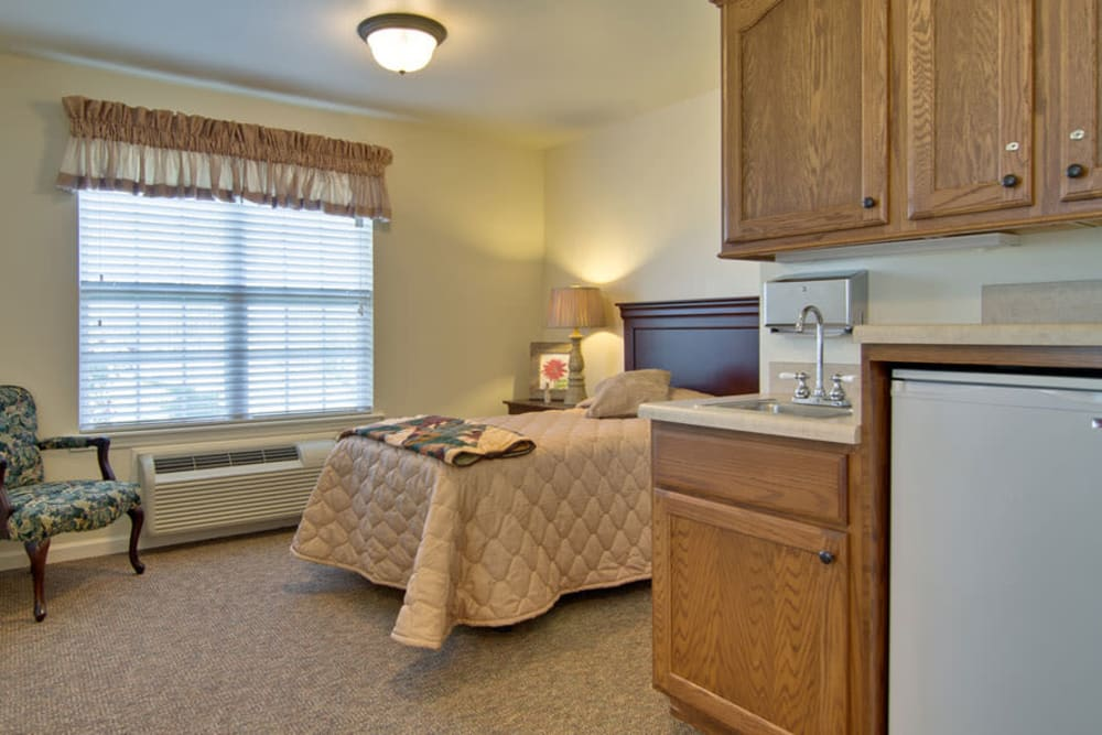 Apartment kitchen with a view of the bedroom at Hartmann Village Senior Living in Boonville, Missouri