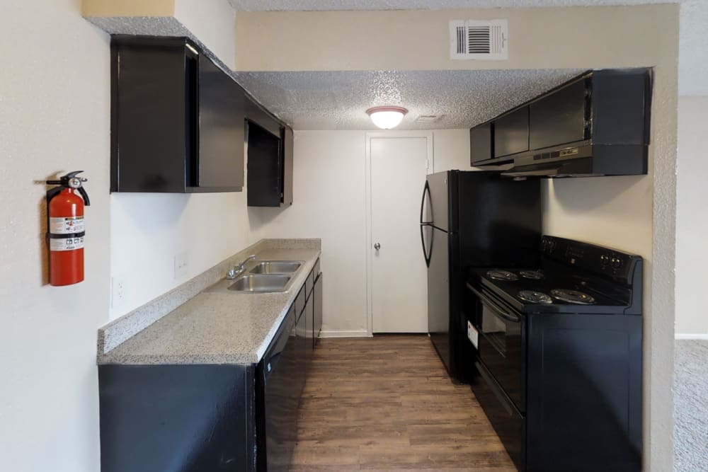 Modern kitchen at Maple Trail Apartments & Townhomes in Pasadena, Texas