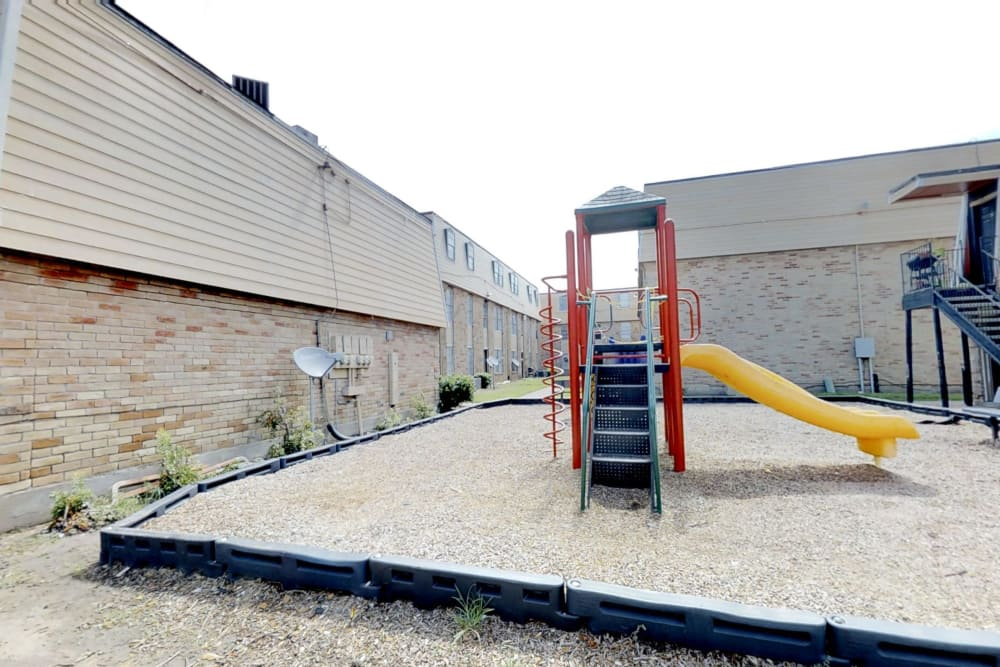 Outdoor Playground at Maple Trail Apartments & Townhomes in Pasadena, Texas