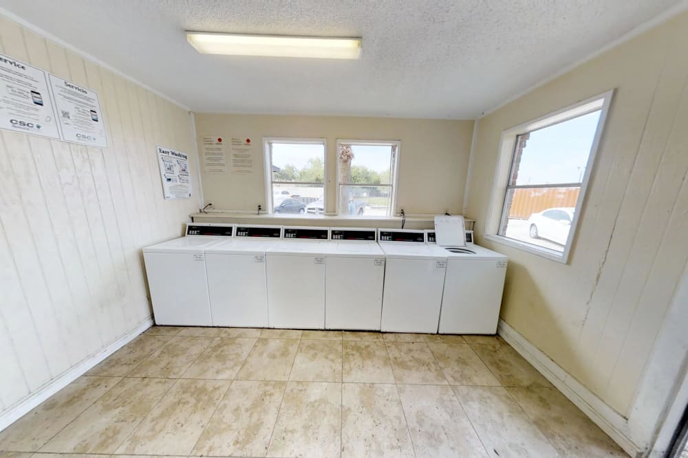 Laundry room at Maple Trail Apartments & Townhomes in Pasadena, Texas