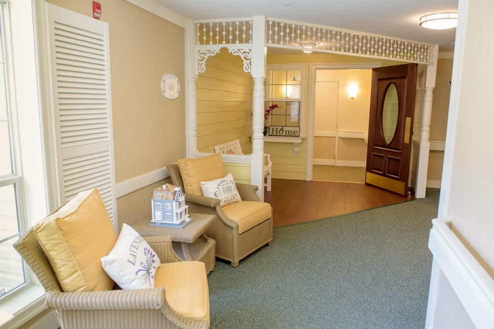 Entryway with yellow accents at Artis Senior Living of Bartlett in Bartlett, Illinois