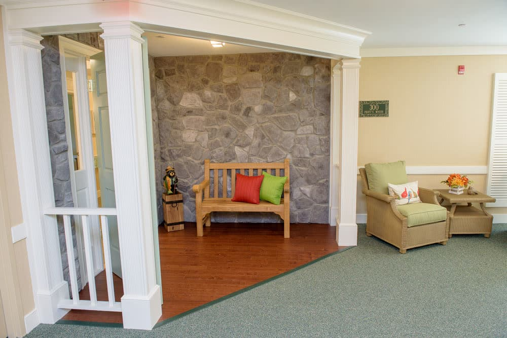 Entryway with green accents at Artis Senior Living of Bartlett in Bartlett, Illinois