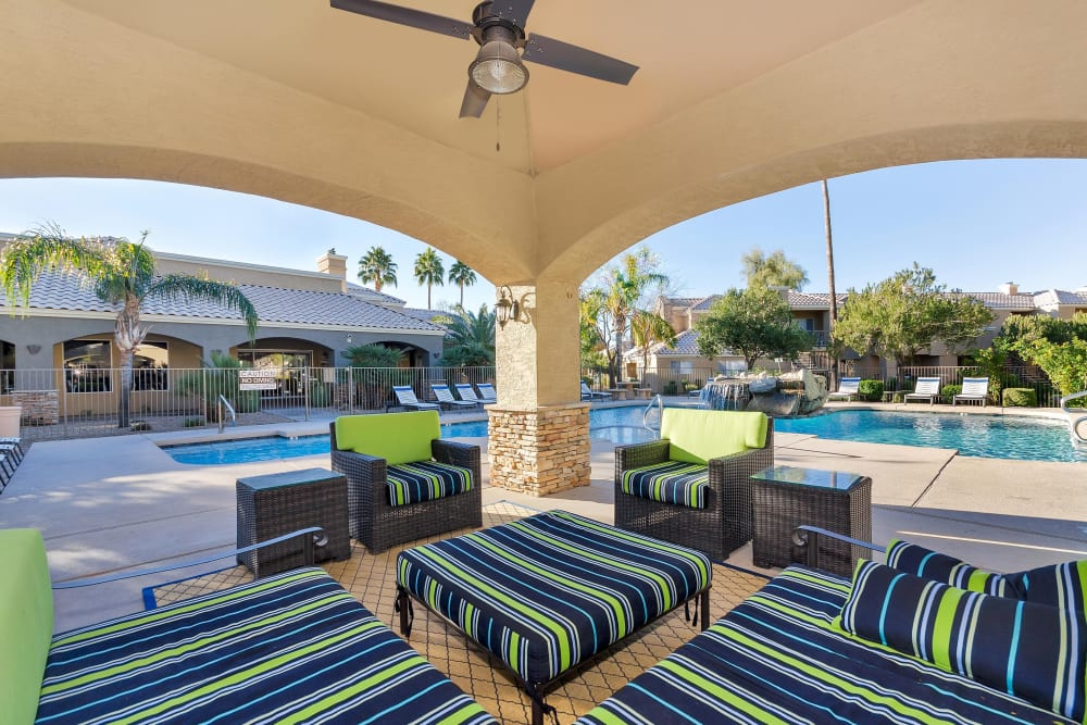 Outdoor shaded resident lounge near the pool at The Boulevard in Phoenix, Arizona