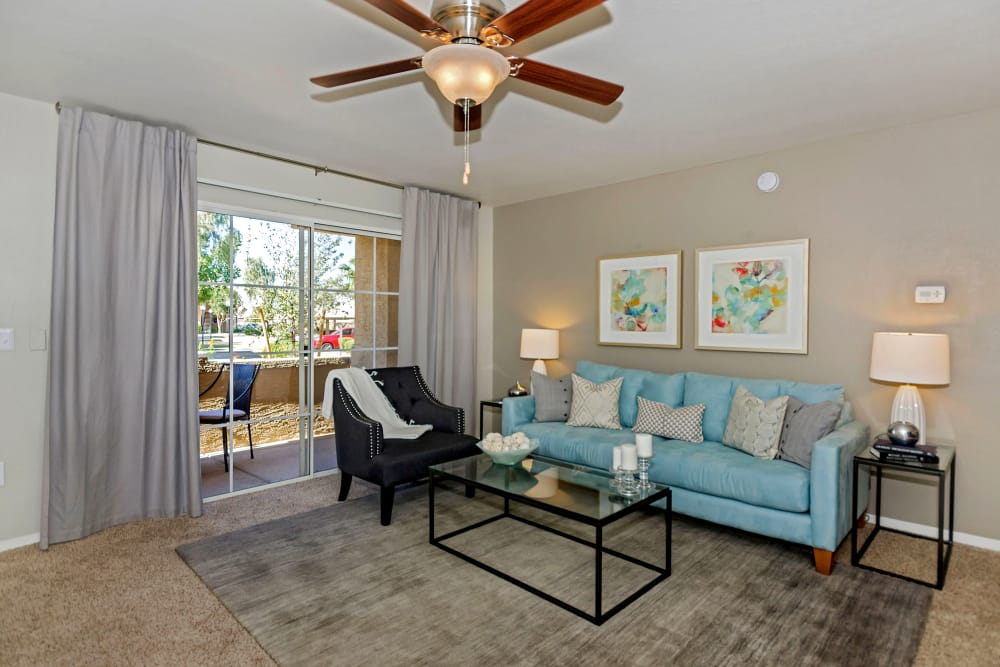 Living room with ceiling fan at The Boulevard in Phoenix, Arizona