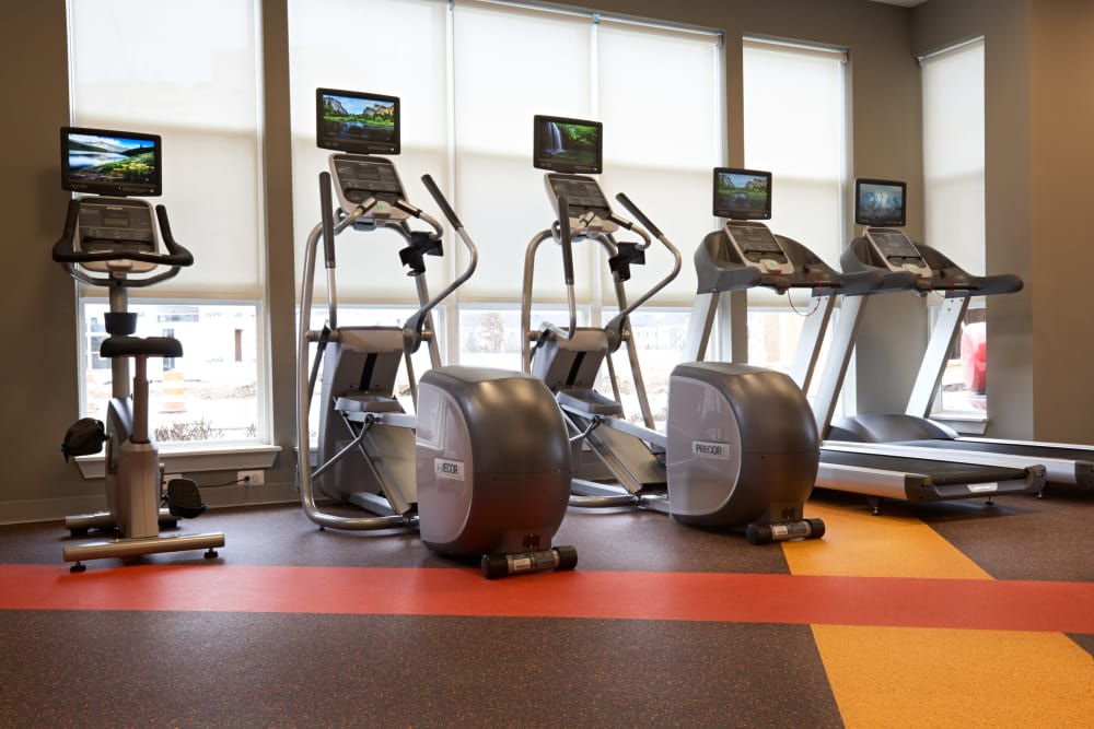 Row of cardio machines in the fitness center at Five Points in Auburn Hills, Michigan