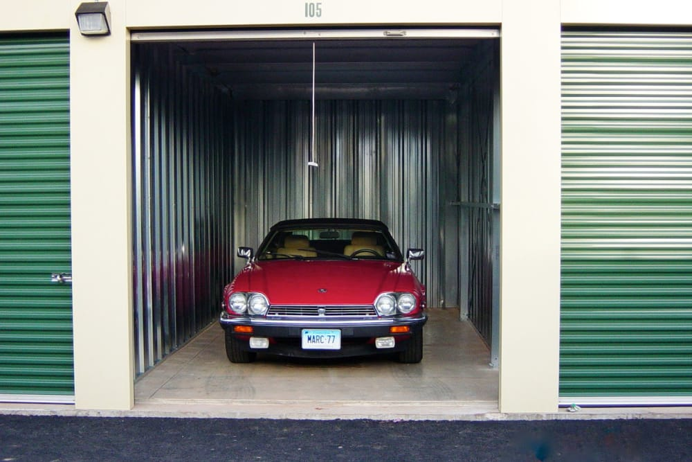 Red car in storage at Mansfield Self Storage in Mansfield, Connecticut