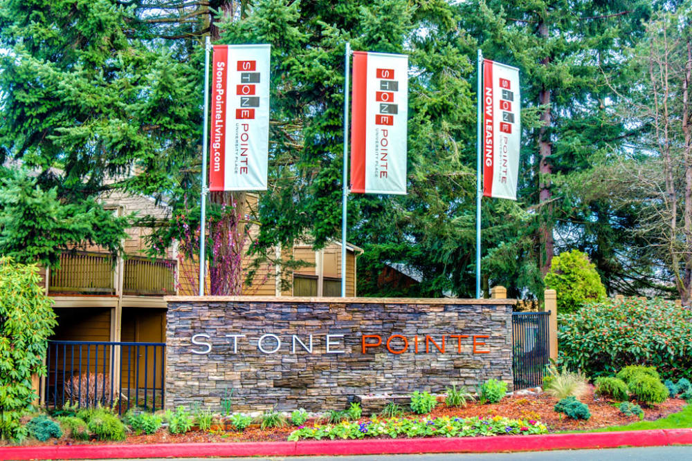 Monument sign welcomes residents and guests at StonePointe in University Place, Washington