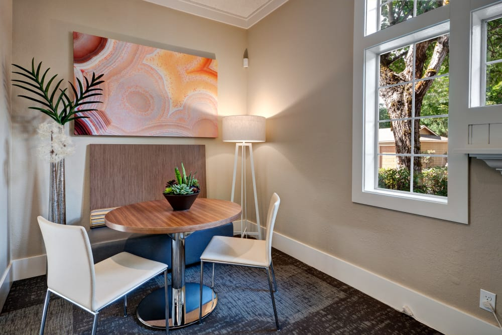 Relaxing nook for reading or visiting with neighbors in the resident clubhouse at StonePointe in University Place, Washington