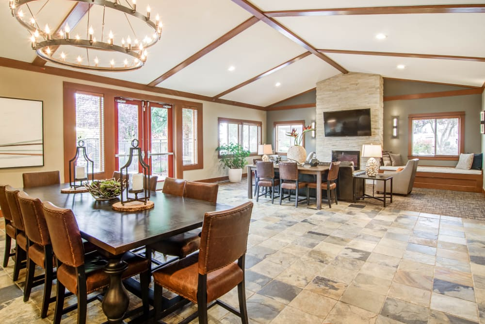 Spacious resident clubhouse with meeting tables and flatscreen TV at Montair at Somerset Hill in Tumwater, WA