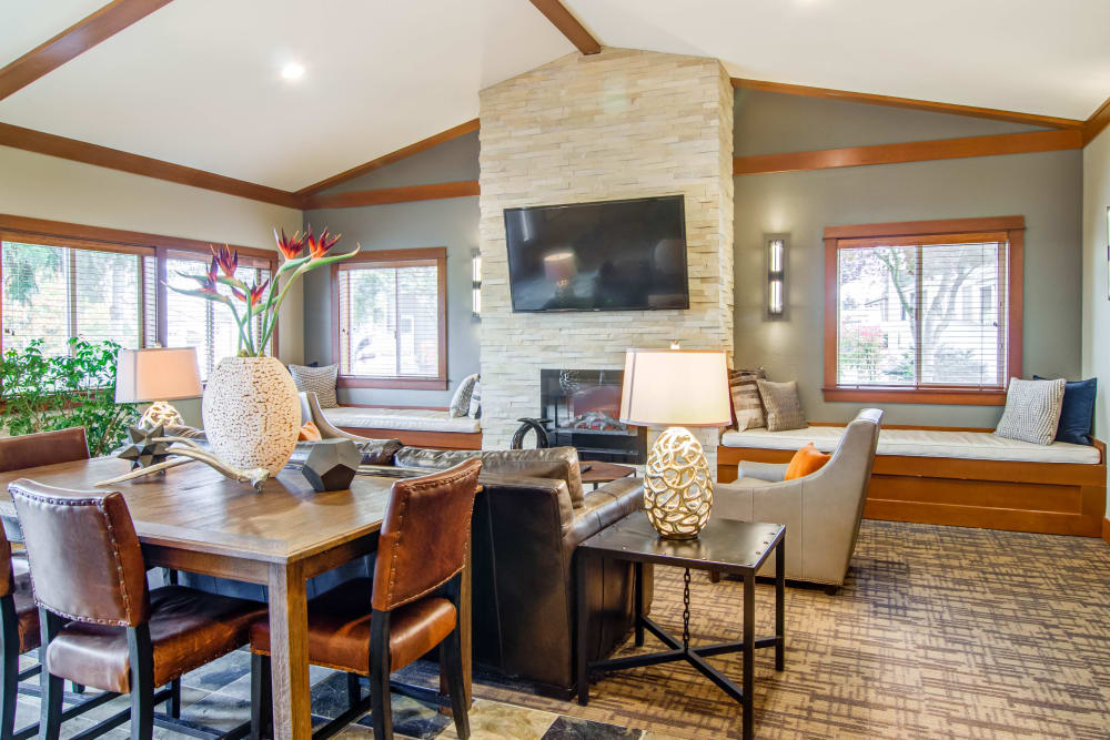 Comfortable seating in front of the fireplace in the resident clubhouse at Montair at Somerset Hill in Tumwater, WA