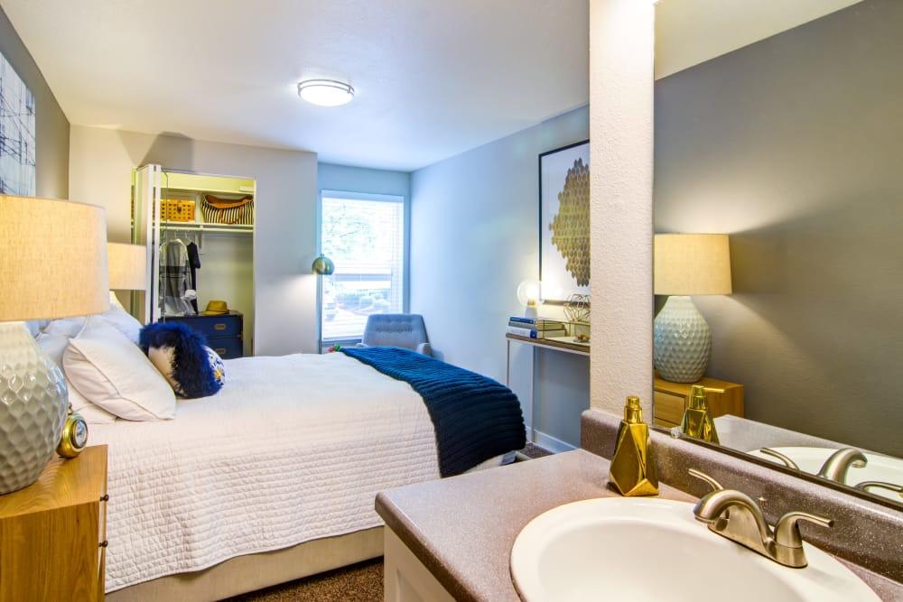 View of bedroom from ensuite bathroom in model home at Heatherbrae Commons in Milwaukie, Oregon