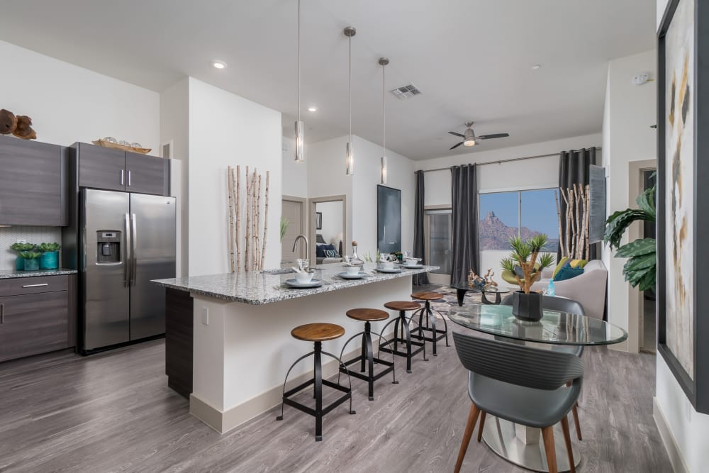 Kitchen with upgraded appliances and seating at the island at The District at Scottsdale in Scottsdale, Arizona