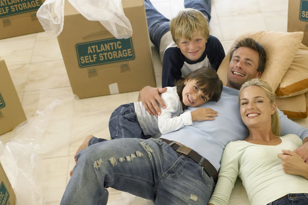 Family moving into their new home after storing their belongings at Atlantic Self Storage in Saint Johns, Florida