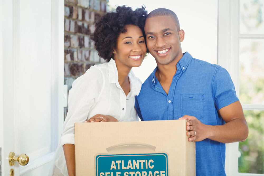 Couple holding an Atlantic Self Storage box