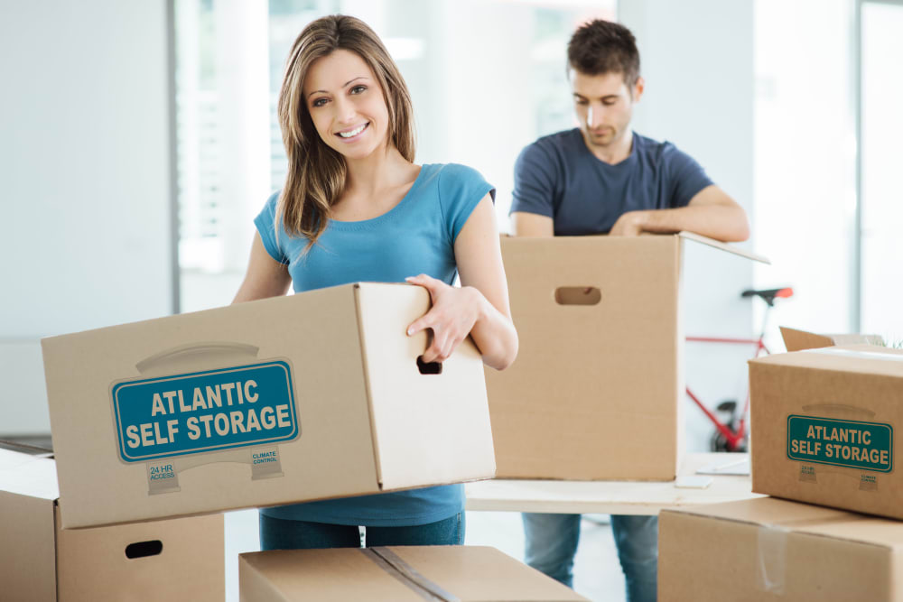 Atlantic Self Storage boxes being used by a happy couple