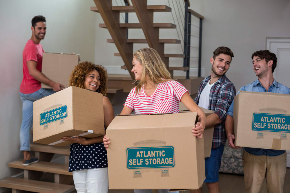 Family using Atlantic Self Storage boxes