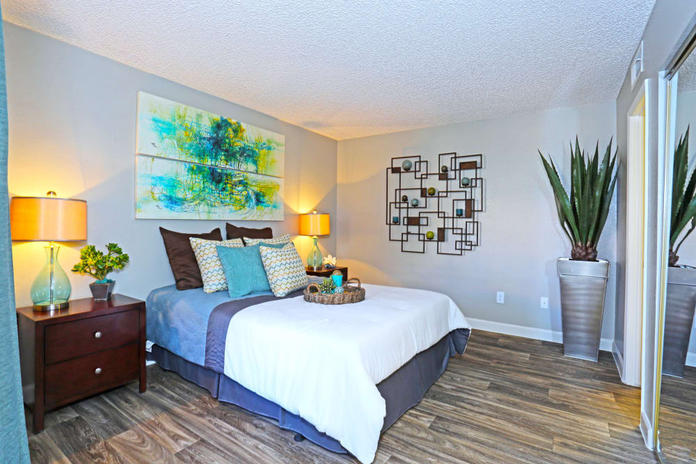 Spacious bedroom with hardwood-style floors in model home at Solis at Flamingo in Las Vegas, Nevada