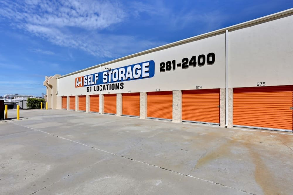 Outdoor storage units with orange doors at A-1 Self Storage in San Diego, California