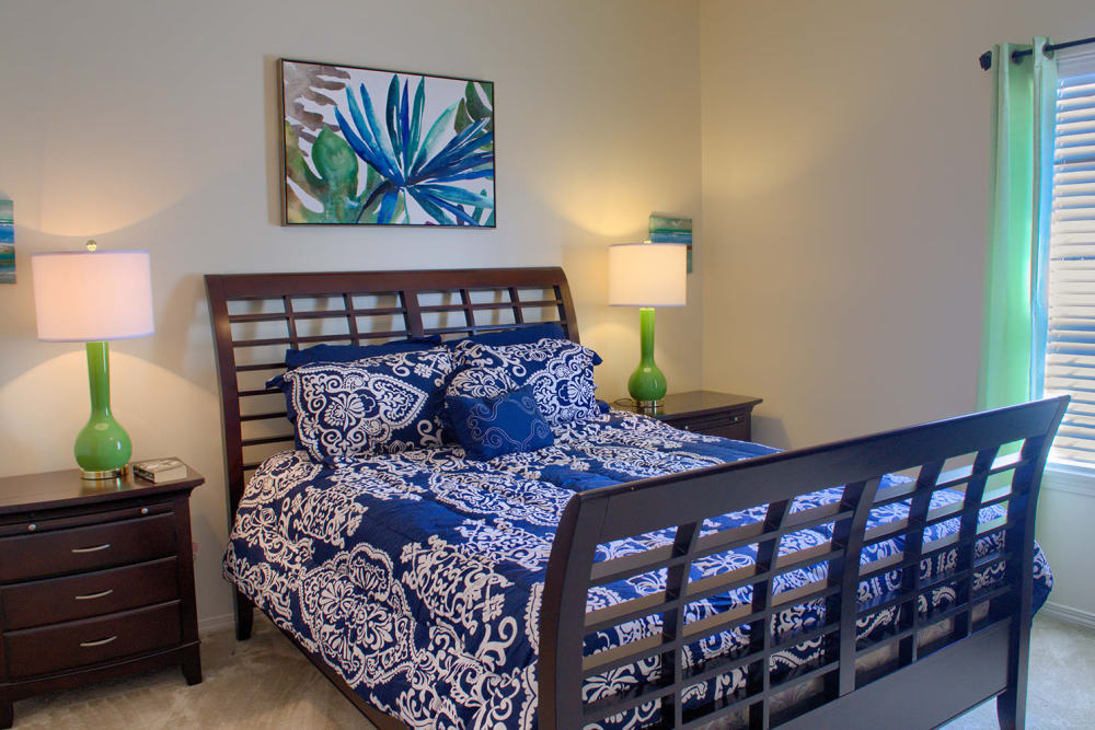Sun-lit bedroom at Oxford Point in Gulfport, Mississippi