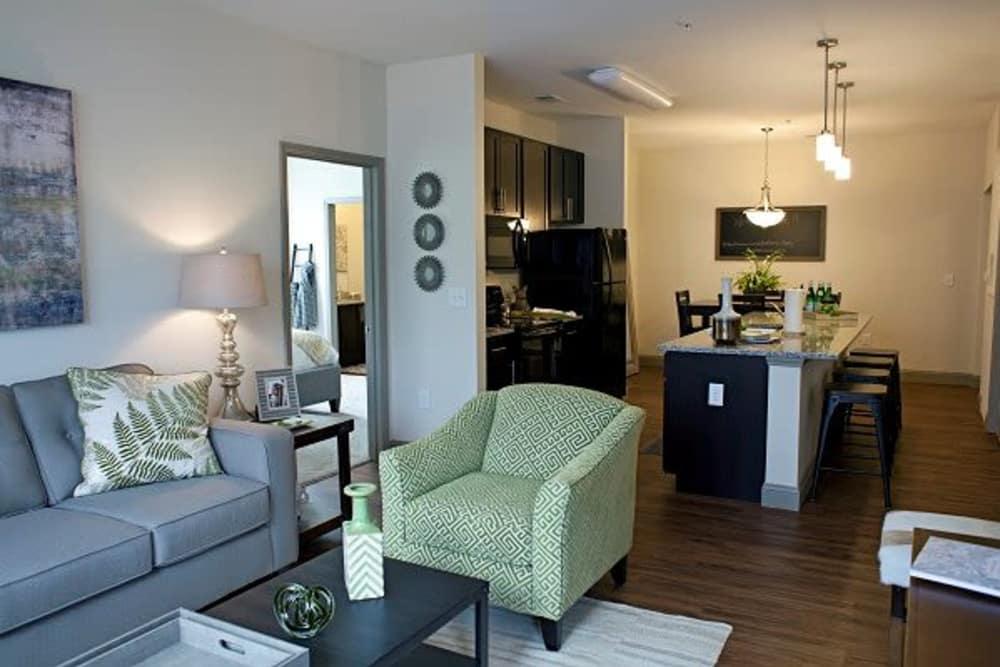 Modern living room at Watercourse Apartments in Graham, North Carolina