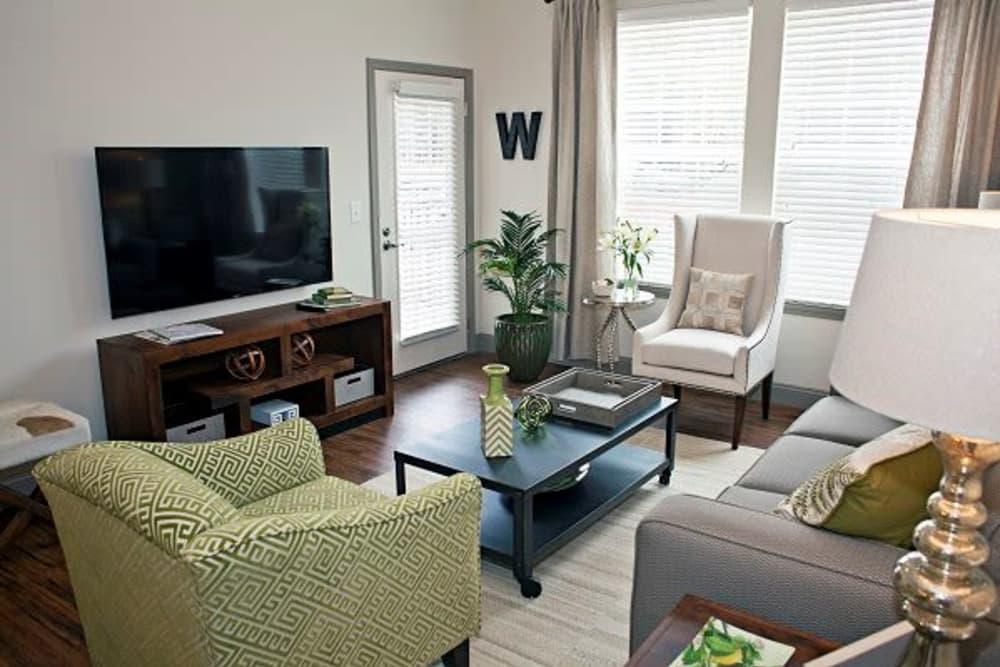 Beautiful living room at Watercourse Apartments in Graham, North Carolina