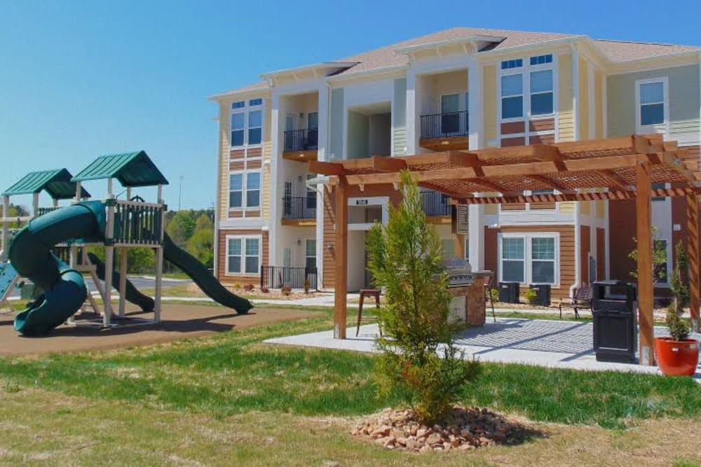 Watercourse Apartments offers a spacious playground in Graham, North Carolina