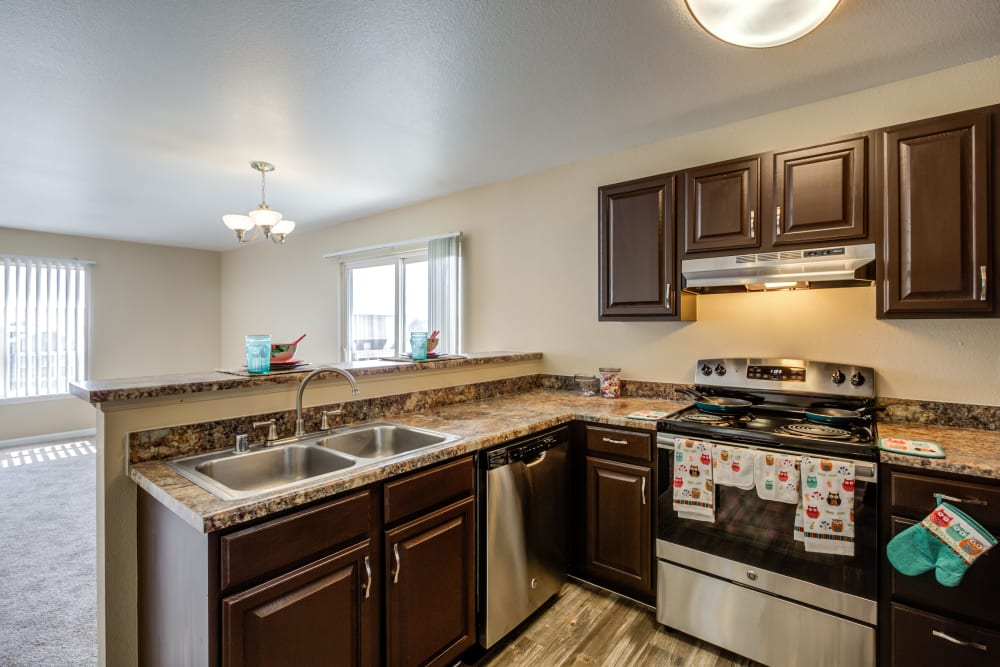 Kitchen with Modern Appliances at Belle Creek Apartments in Henderson, Colorado