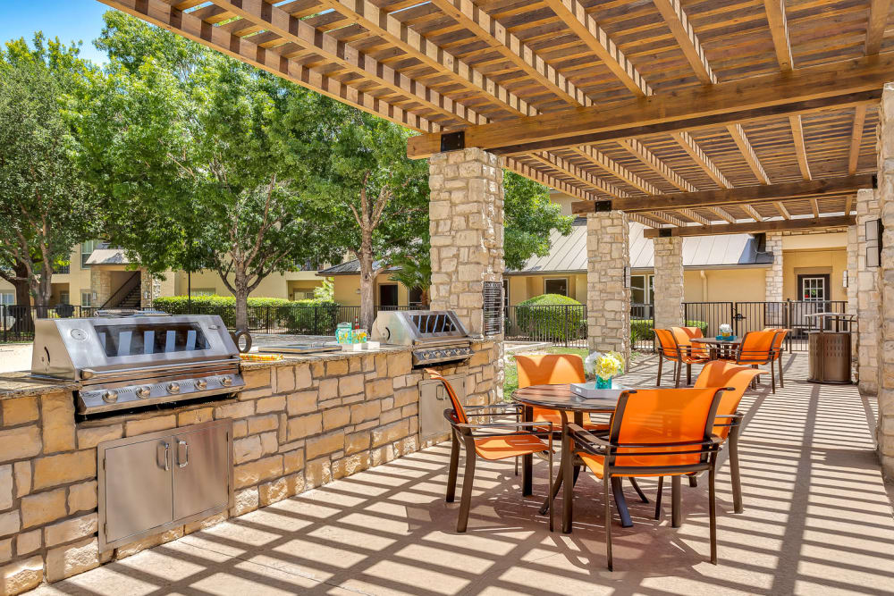 BBQ area by the pool at Villas at Oakwell Farms in San Antonio, Texas