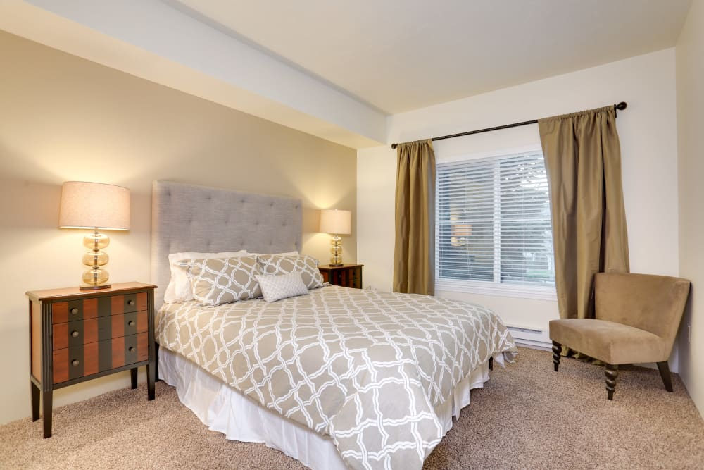 Spacious master bedroom in model home at Big Trout Lodge in Liberty Lake, Washington